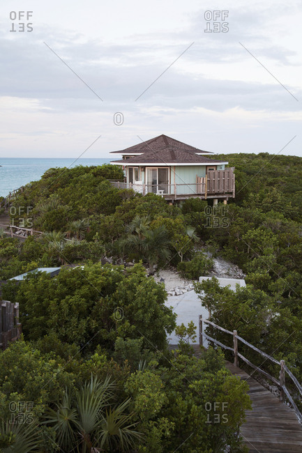 EXUMA, Bahamas. - October 27, 2011:  Cottages and the grounds on Fowl Cay Resort at dusk.