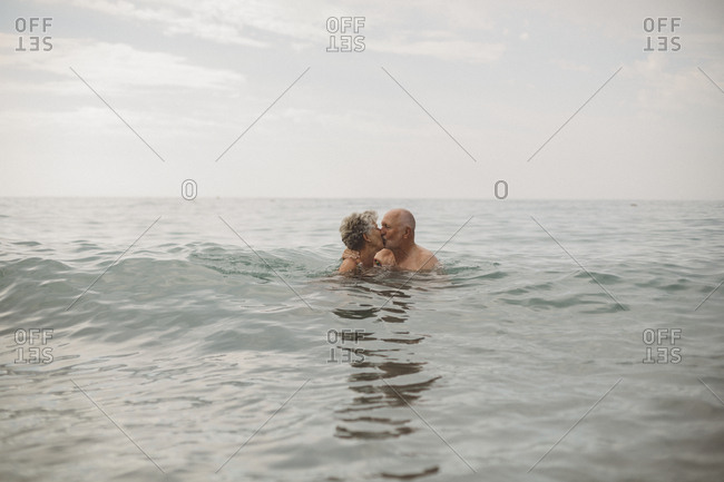 Senior couple bathing in sea