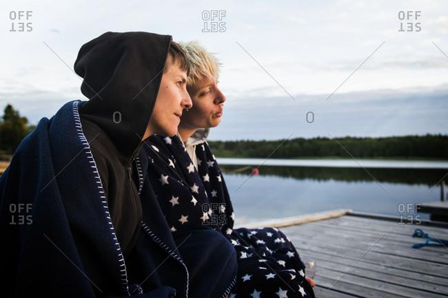 Men sitting on jetty - Offset
