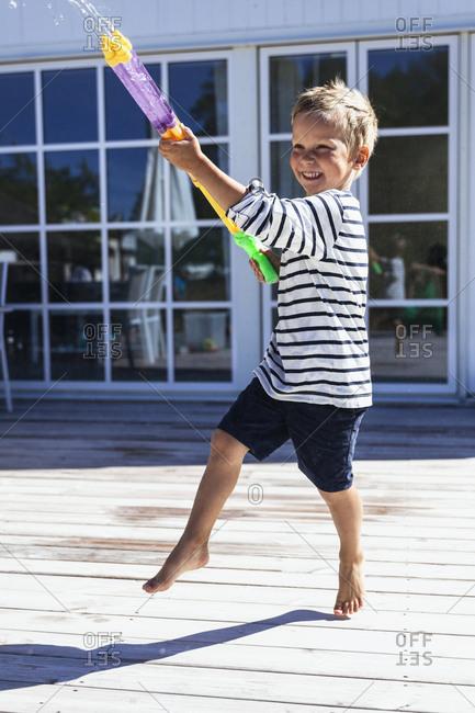 Boy playing with water gun