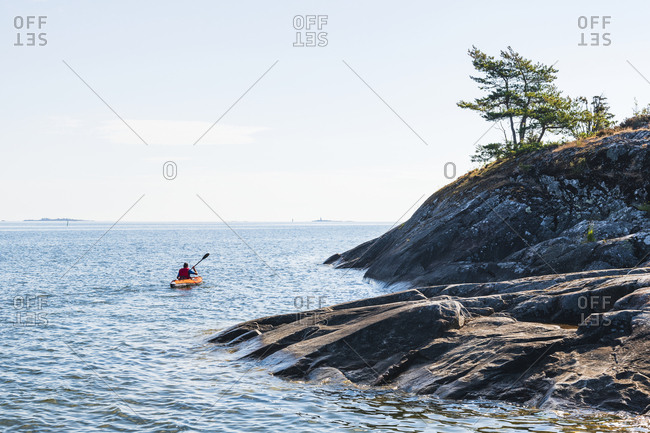 Man kayaking on sea