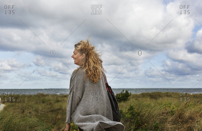 Smiling woman looking at view