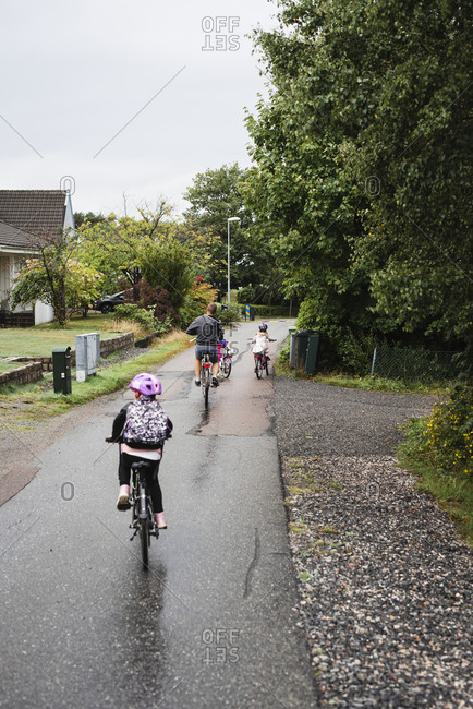 Father and daughters cycling