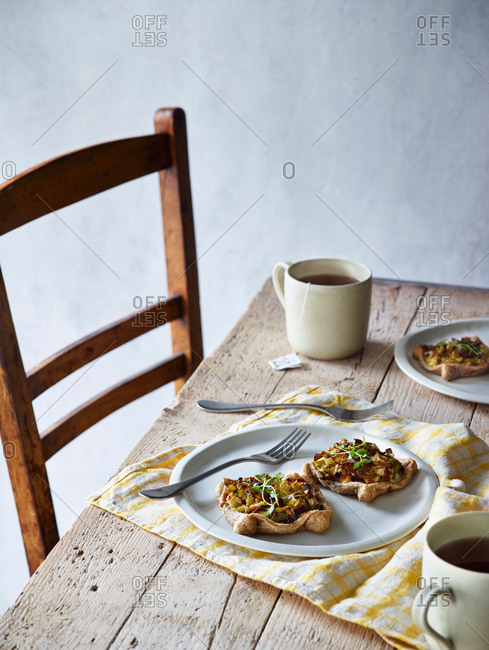 Savory breakfast tarts served on rustic wooden table