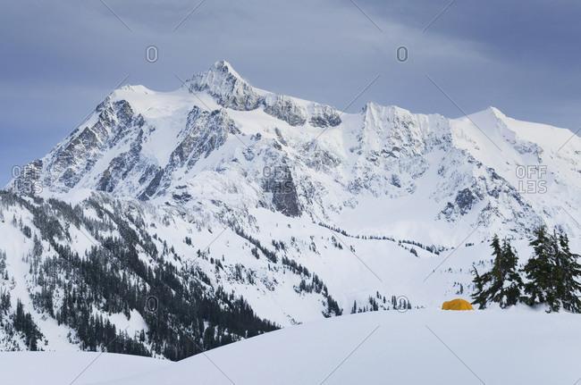 Rocky mountain overlooking snowy landscape,Heather Meadows, Washington, USA
