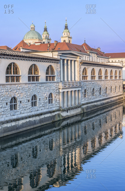 Ornate building reflected in river, Ljubljana, Central Slovenia, Slovenia,Ljubljana, Central Slovenia, Slovenia