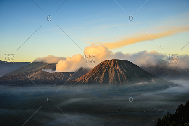 High angle view of clouds under smoking volcano,Mount Bromo, Surabaya, Indonesia