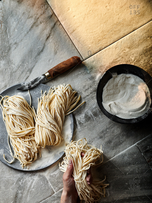 Person making pasta - Offset Collection