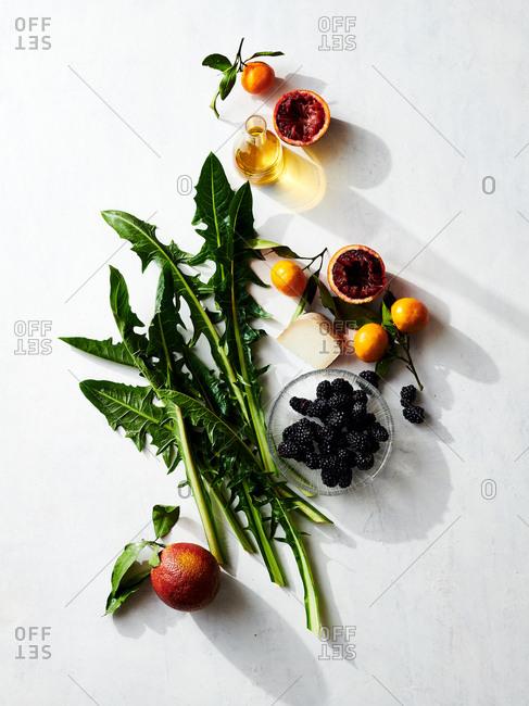 Dandelion greens and other salad ingredients