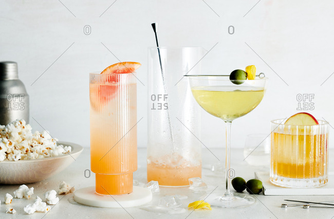Normandine Club Spritz, Doubting Duck, Old Fashioned and popcorn on white marble