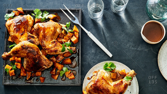 Spicy chicken quarters with sweet potatoes