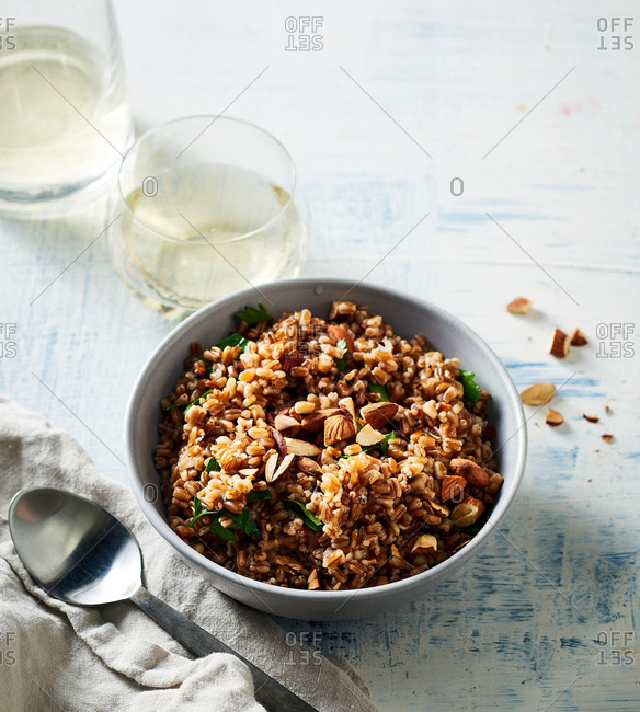 Herb infused wheat berry pilaf and white wine