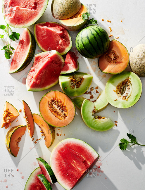 A variety of whole and sliced melons