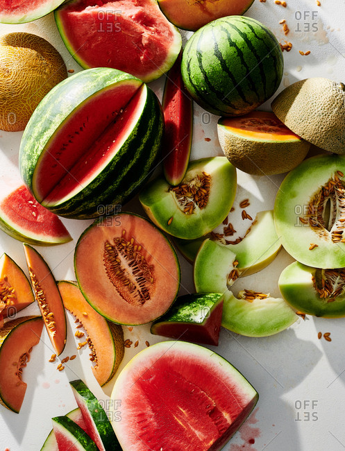 Whole and sliced melons