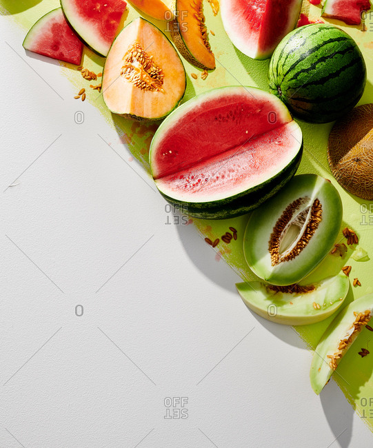 A variety melons whole and sliced
