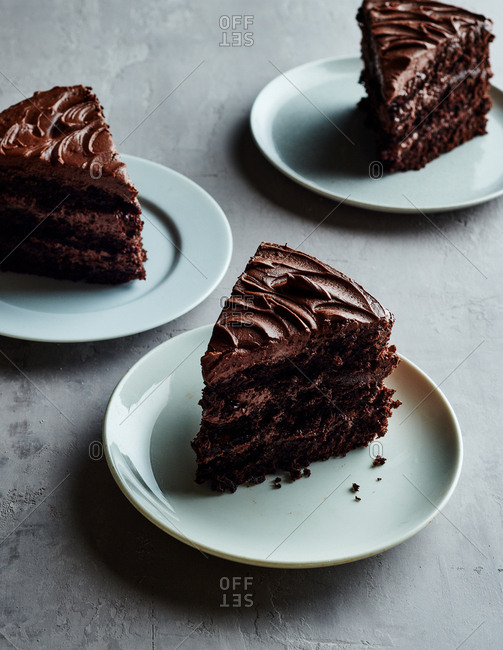 Chocolate cake sliced and served on plates