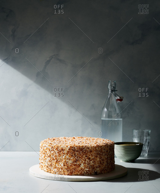 Whole coconut cake on gray background