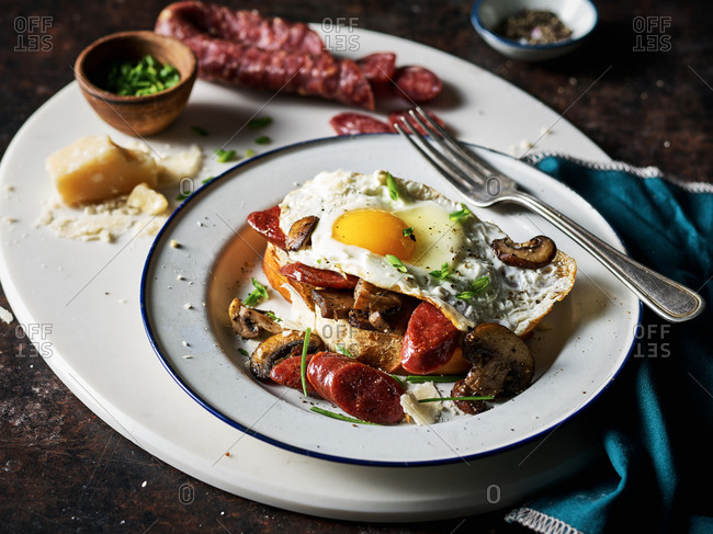 Egg on toast with mushrooms and salami