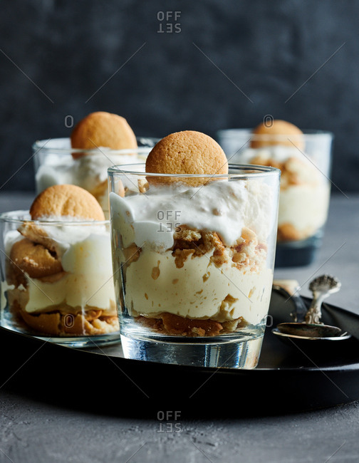 Small glass cups of banana pudding with vanilla wafers