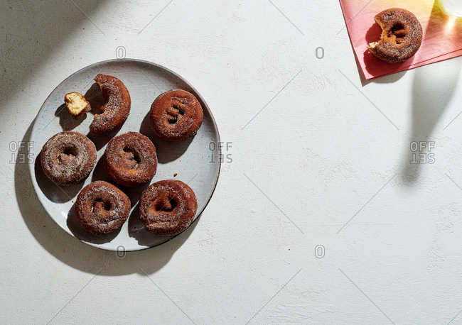 Sugared apple cider doughnuts on a ceramic plate