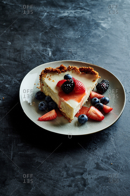 Once slice of cheesecake and berries on a ceramic plate