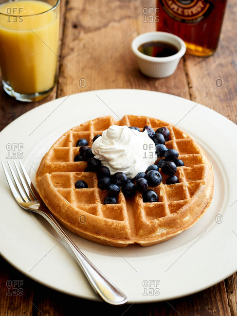 Handmade Belgian waffles with blueberries and cream