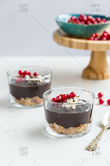 Chocolate mouse topped with red currant and almonds