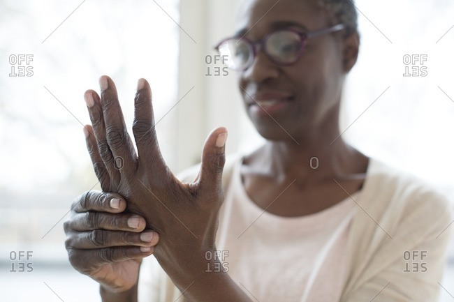 Mature woman with painful hand.