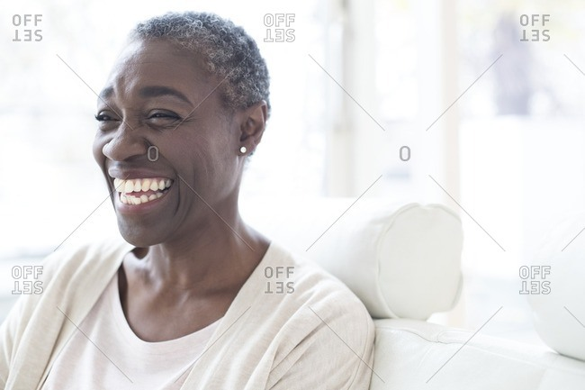 Mature woman smiling and laughing.