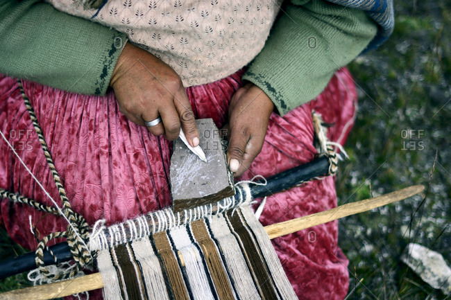 Aymara artisan woman weaving with wool
