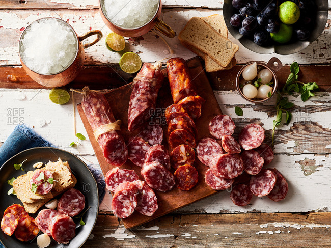 Overhead view of fresh meat on a charcuterie board