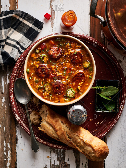 Spicy gumbo dish served with bread