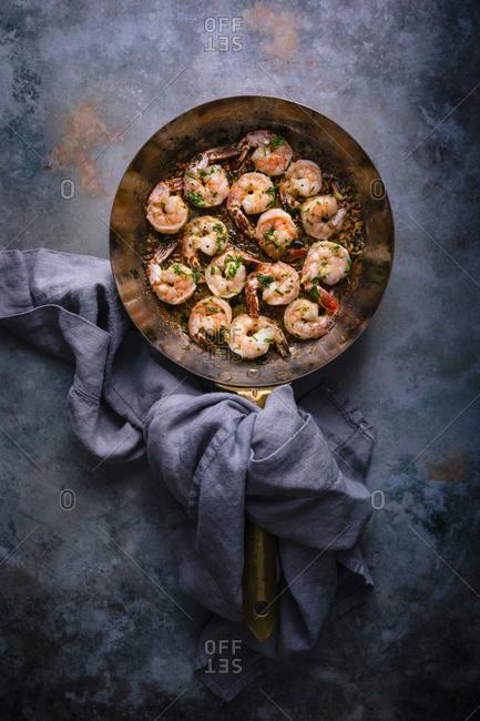 Sauteed garlic shrimp in copper pan