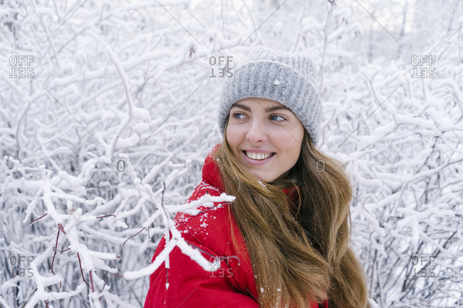 close-up laughing woman in red down jacket on a winter background