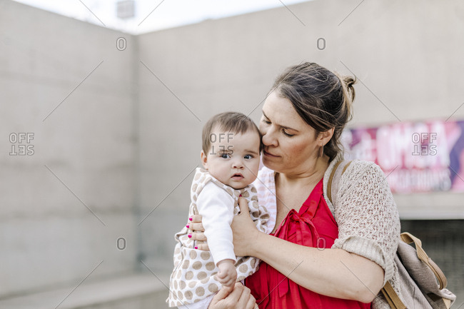 Mother holding and comforting baby outdoor