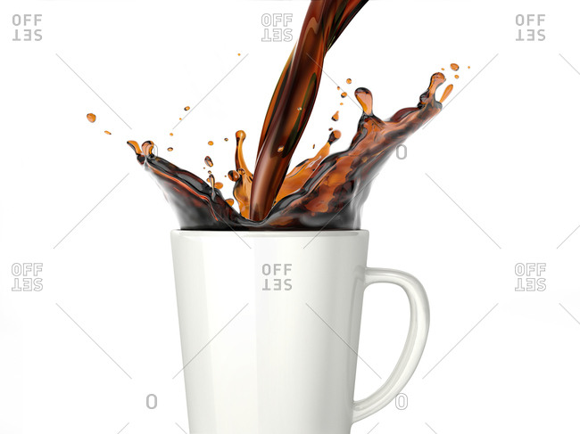 Pouring coffee into a white mug isolated on white background