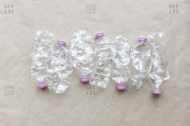 Plastic bottles on paper background. image ready for a Recycle concept. Copy space.