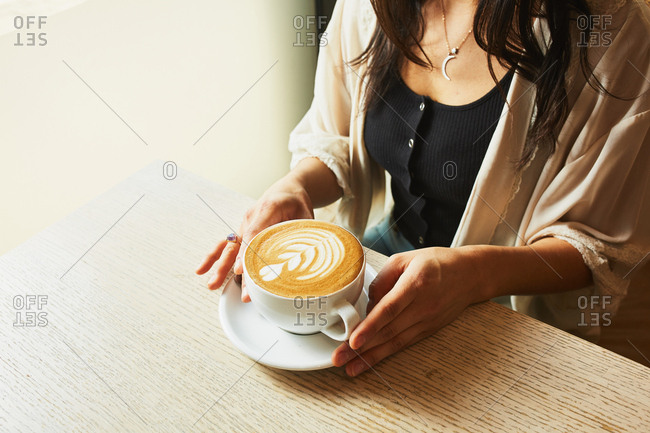 Woman with a Rosetta cappuccino