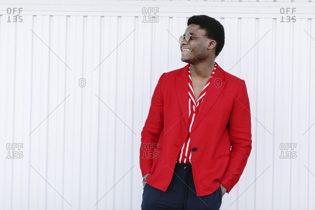 Portrait of a stylish black man wearing red blazer