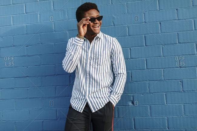 Portrait of a stylish black man wearing blue striped collared shirt
