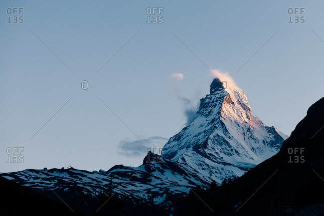 Sunset light on the Matterhorn mountain peak in Zermatt Switzerland