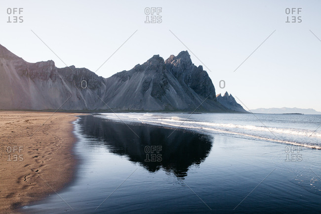 Mountain reflection in Iceland on the beach