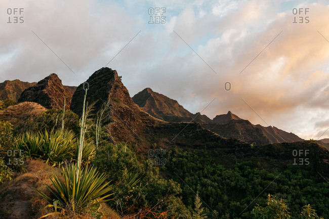 Sunset over mountains in Hawaii on Kalalau trail