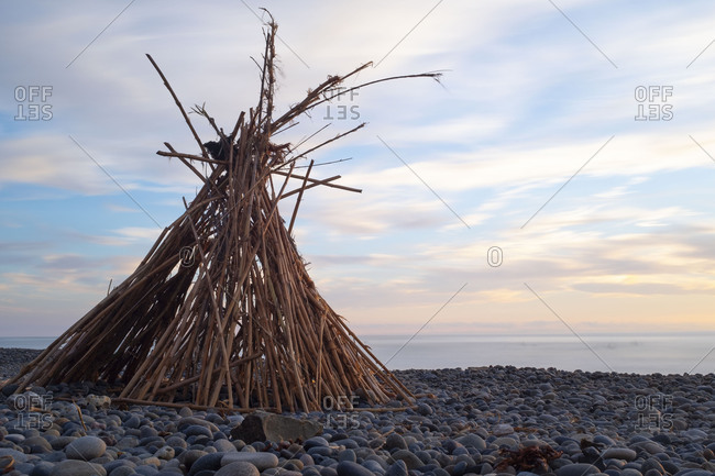 Bamboo Teepee on rocky beach