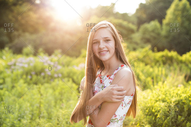 , Smiling Teenage Girl With in Field in Sunlight