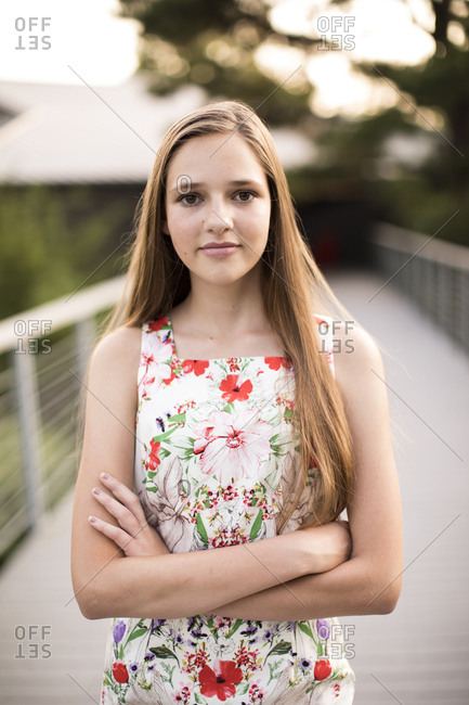 Headshot of Beautiful Teenage Girl on Bridge with Arms Crossed