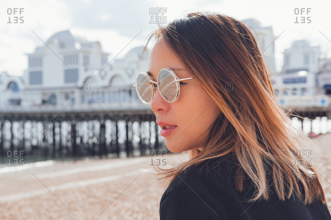 Asian woman wearing sunglasses on the beach