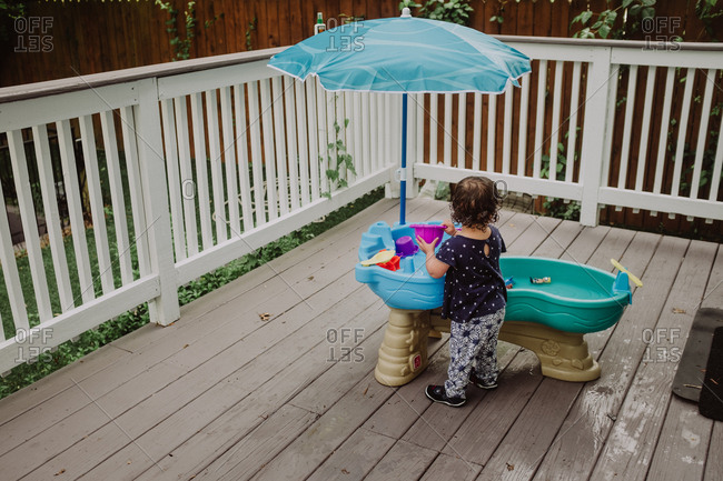 Child playing with water table