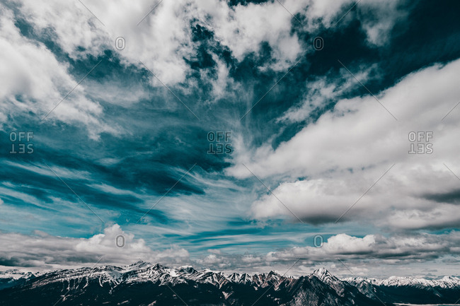 Majestic Cloud Formations Over A Jawline Canadian Mountains