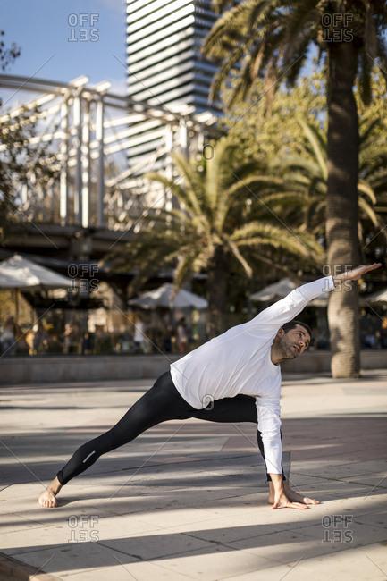 Man doing Yoga in urban area